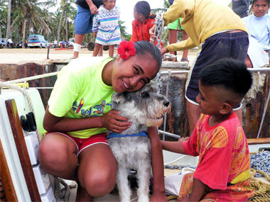 Aitutaki Kids enjoying the only dog on the island